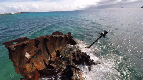 Aerial-over-a-rusting-shipwreck-in-the-harbor-of-Tuvalu