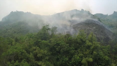 Aerial-over-a-slash-and-burn-mountainside-burning
