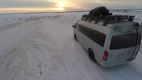 Aerial-as-a-truck-drives-across-frozen-tundra-in-the-Russian-Arctic-in-Siberia