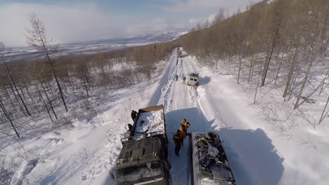 Aerial-of-cars-and-trucks-stuck-in-the-snow-in-the-wilderness-of-Siberia