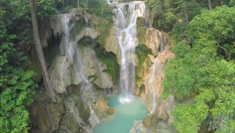 Aerial-over-a-small-tropical-waterfall-in-a-jungle-setting