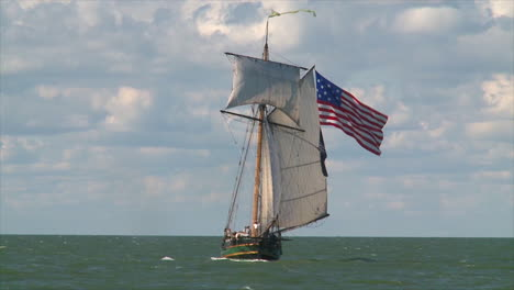 A-19th-century-tall-masted-clipper-ship-sails-on-the-high-seas-flying-an-American-flag