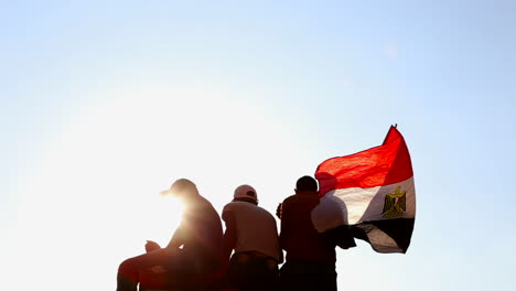 Protestors-wave-the-Egyptian-flag-in-Cairo-Egypt