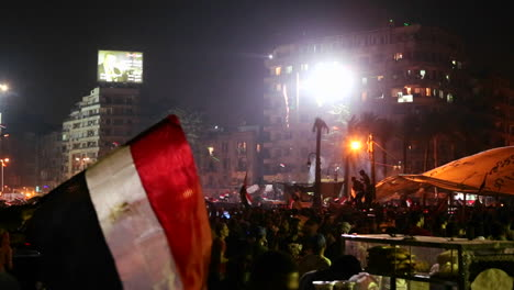 A-large-nighttime-rally-with-fireworks-in-Tahrir-Square-in-Cairo-Egypt