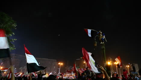 Protestors-wave-flags-and-fireworks-go-off-at-a-nighttime-rally-in-Cairo-Egypt-1