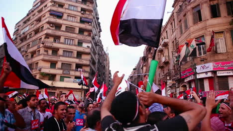 Protestors-chant-and-wave-flags-in-Cairo-Egypt