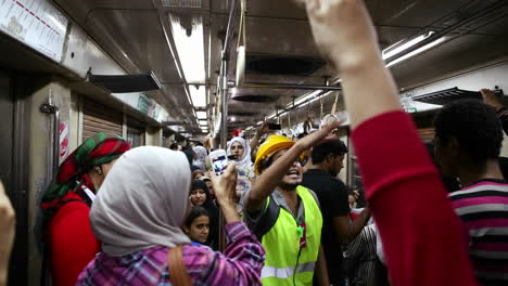 Protestors-chant-while-aboard-a-metro-in-Cairo-Egypt
