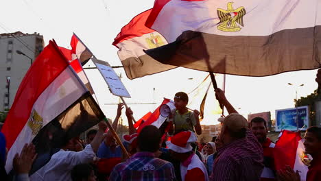 The-sun-shines-through-protestor-s-flags-in-Cairo-Egypt