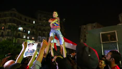 A-protestor-is-hoisted-on-the-shoulders-of-others-during-a-night-demonstration-in-Cairo-Egypt