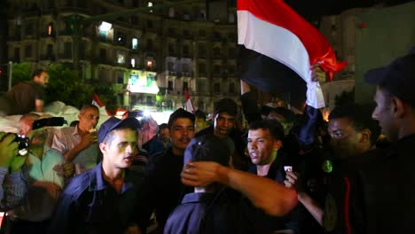 Protestors-chant-at-a-nighttime-rally-in-Cairo-Egypt
