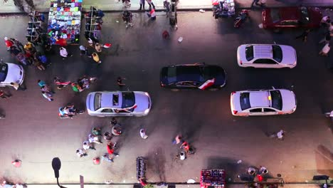View-from-overhead-looking-straight-down-as-protestors-march-in-the-streets-of-Cairo-Egypt-at-night
