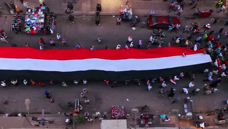 View-from-overhead-looking-straight-down-as-protestors-carrying-banners-march-in-the-streets-of-Cairo-Egypt-2