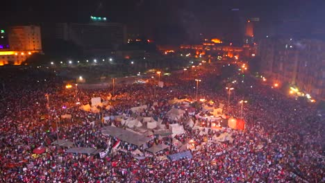 Fireworks-go-off-above-protestors-gathered-in-Tahrir-Square-in-Cairo-Egypt-at-a-large-nighttime-rally