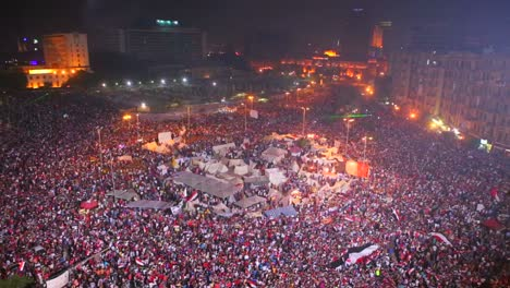 Fireworks-go-off-above-protestors-gathered-in-Tahrir-Square-in-Cairo-Egypt-at-a-large-nighttime-rally-2