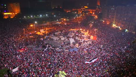 Fireworks-go-off-above-protestors-gathered-in-Tahrir-Square-in-Cairo-Egypt-at-a-large-nighttime-rally-3