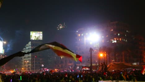 View-from-the-ground-as-protestors-chant-and-wave-flags-at-a-large-nighttime-rally-in-Tahrir-Square-in-Cairo-Egypt-2
