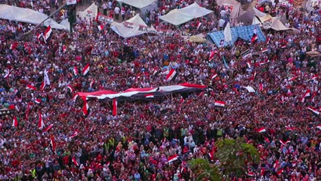 Overhead-view-as-protestors-wave-flags-and-jam-Tahrir-Square-in-Cairo-Egypt