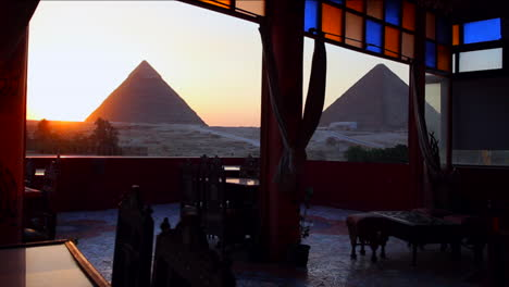 The-pyramids-of-Egypt-are-seen-through-the-windows-of-a-cafe