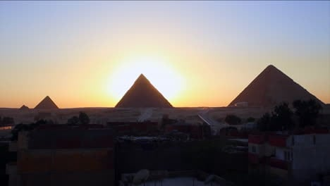 Sunrise-behind-the-great-pyramids-of-Giza-1