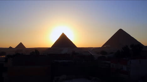 Sunrise-behind-the-great-pyramids-of-Giza-2