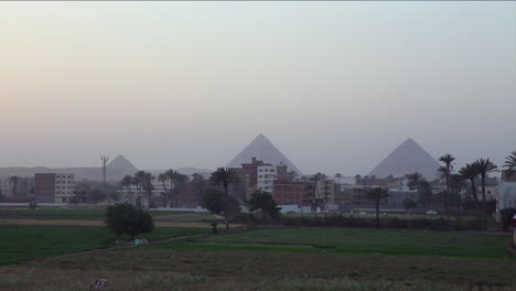 The-pyramids-of-Egypt-are-seen-in-the-distance-behind-the-Cairo-skyline
