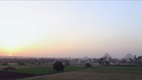 The-pyramids-of-Egypt-are-seen-at-a-distance-at-sunset