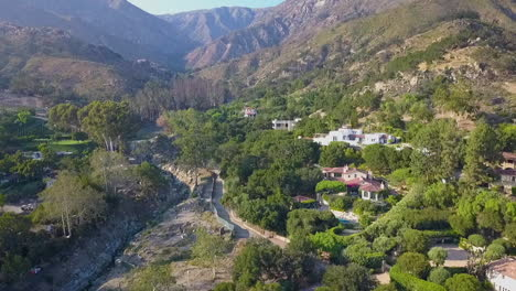 Aerial-Pan-Down-Shot-Over-The-Destruction-And-Debris-Flow-Mudslide-Area-During-The-Montecito-Flood-Disaster