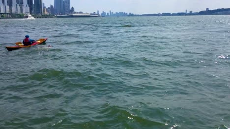 A-Swimmer-Swims-Up-The-Hudson-River-With-New-York-City-In-The-Background
