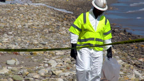 Workers-Clean-Up-After-The-Massive-Beach-Cleanup-Effort-Following-The-Refugio-Oil-Spill-In-Santa-Barbara