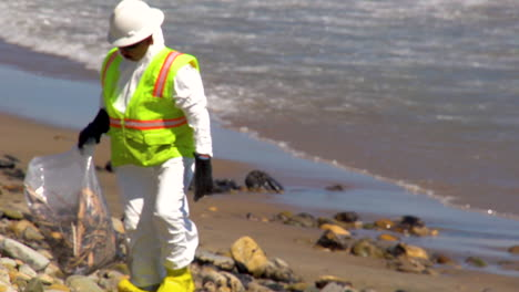 Workers-Clean-Up-After-The-Massive-Beach-Cleanup-Effort-Following-The-Refugio-Oil-Spill-In-Santa-Barbara-1