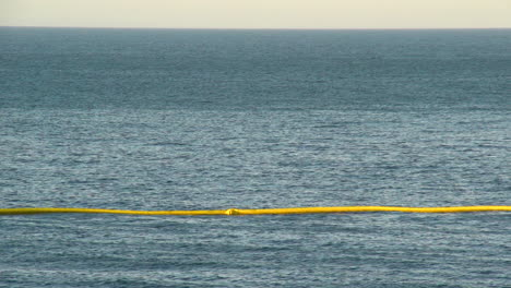 Emergency-Boats-Lay-Out-A-Protective-Net-After-The-Massive-Beach-Cleanup-Effort-Following-The-Refugio-Oil-Spill