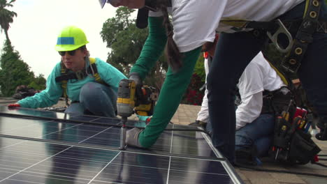 Workers-Install-Solar-Panels-On-The-Roof-Of-A-Middle-Class-House-3