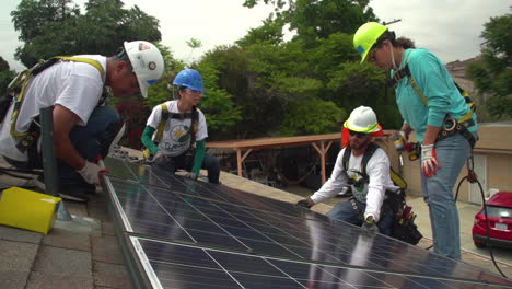 Workers-Install-Solar-Panels-On-The-Roof-Of-A-Middle-Class-House-4