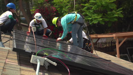 Workers-Install-Solar-Panels-On-The-Roof-Of-A-Middle-Class-House-5