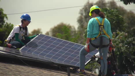 Workers-Install-Solar-Panels-On-The-Roof-Of-A-Middle-Class-House-6