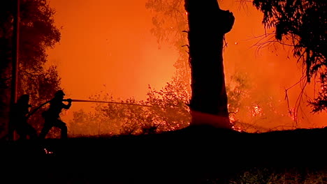 A-Firefighter-Stands-In-Silhouette-And-Fights-A-Huge-Hillside-Blaze-During-The-Holiday-Fire-1