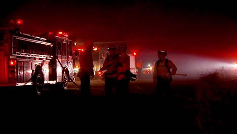Firefighters-Discuss-Strategy-Around-Their-Trucks-During-The-Holiday-Fire-In-Goleta-California
