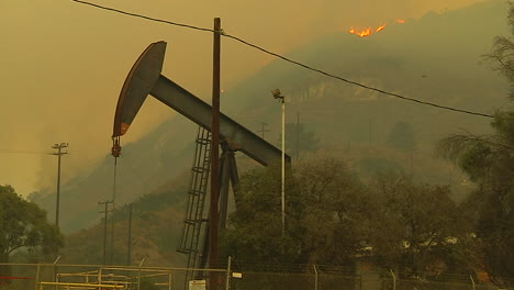 The-Hills-Behind-An-Oil-Derrick-Between-Ventura-And-Santa-Barbara-Burn-During-The-Thomas-Fire
