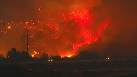 The-Thomas-Fire-Burns-At-Night-In-The-Hills-Above-The-101-Freeway-Near-Ventura-And-Santa-Barbara-California