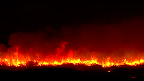 The-Thomas-Fire-Burns-At-Night-In-The-Grass-Above-The-101-Freeway-Near-Ventura-And-Santa-Barbara-California
