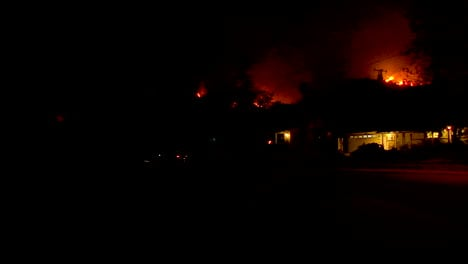 Residents-Water-Down-Their-Homes-And-Yards-As-The-Thomas-Fire-Approaches-In-The-Hills-Of-Ventura-And-Santa-Barbara