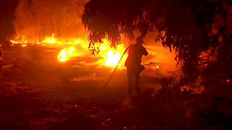 Firefighters-Work-Hard-To-Contain-Brush-Fires-Burning-Out-Of-Control-During-The-Thomas-Fire-In-Ventura-County-California