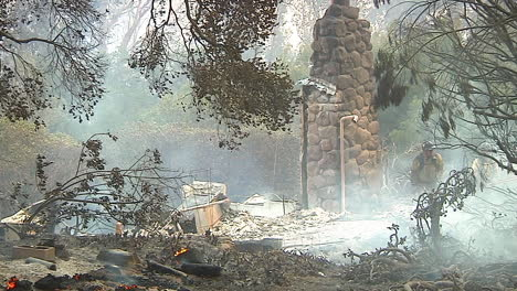 Fire-Crews-Mop-Up-Around-A-Burned-And-Charred-Home-Following-The-Destructive-Thomas-Fire-2
