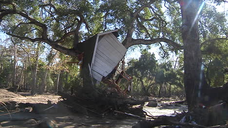 Part-Of-A-House-Is-Lieft-In-A-Tree-The-Damage-From-The-Mudslides-In-Montecito-California-Following-The-Thomas-Fire-Disaster