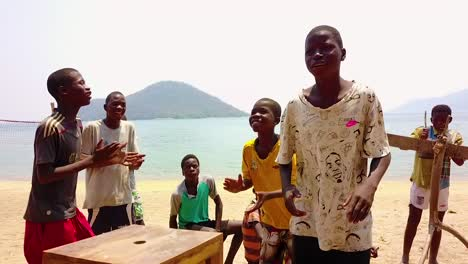 A-Group-Of-African-Amatuer-Musicians-Perform-On-A-Beach-On-Lake-Malawi-Africa