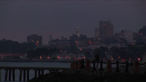 A-Jogger-Has-An-Extraordinary-Nighttime-View-Of-San-Francisco-With-Its-Famous-Landmarks-Etched-Against-The-Sky