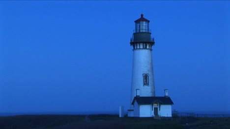 A-White-Flashing-Beacon-Breaks-Up-The-Blue-Tones-Of-This-Footage-Of-A-Lighthouse