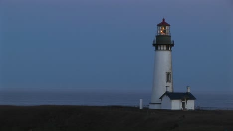 A-Beautiful-Blue-Sky-Is-The-Perfect-Backdrop-For-This-White-Lighthouse-And-The-Keeper-S-Home