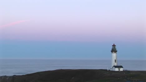 A-Montage-Of-Lighthouse-Longshots-With-A-Pastel-Sky-Above-A-Quiet-Ocean