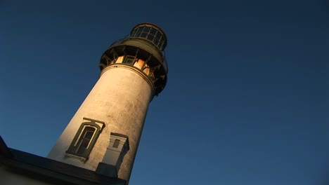 A-Montage-Of-An-Old-Lighthouse-At-A-Jaunty-Angle-In-The-Sunlight